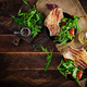 Juicy grilled pork steak with herbs on bone on wooden background. Top view, overhead, flat lay - PhotoDune Item for Sale