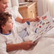 Mother In Bedroom Looking At Picture Book With Young Son Wearing Pyjamas - PhotoDune Item for Sale