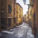 Volterra old town street during a snowfall in winter. Tuscany, Italy - PhotoDune Item for Sale