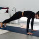 Young slim woman practicing yoga in Plank position in modern minimalistic bedroom at home - PhotoDune Item for Sale