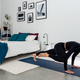 Young slim Woman practicing yoga in modern minimalistic bedroom at home - PhotoDune Item for Sale