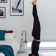 Fit woman practicing a headstand exercise, (salamba sirsasana pose) at her cozy home - PhotoDune Item for Sale
