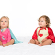 portrait of pretty toddler girls in superhero capes isolated on white - PhotoDune Item for Sale