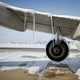Grounded plane at snowy airport in frosty day - PhotoDune Item for Sale