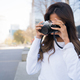 Young woman using a professional camera. - PhotoDune Item for Sale