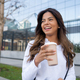 Young woman holding a cup of coffee. - PhotoDune Item for Sale