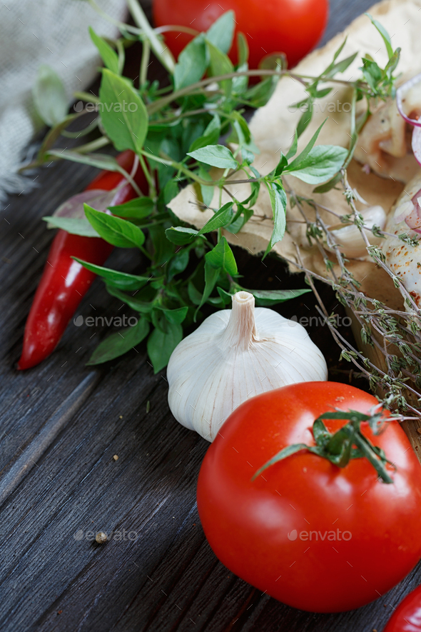 Fresh Raw Chicken with Herbs, Garlic, Onion, Tomatoes and Chilli Pepper - Stock Photo - Images