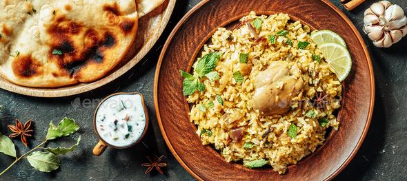 Pakistani chicken biryani rice, top view, copy space - Stock Photo - Images