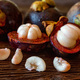 Mangosteen fruit on wooden table close up - PhotoDune Item for Sale