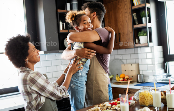 Happy family preparing healthy food in kitchen together - Stock Photo - Images