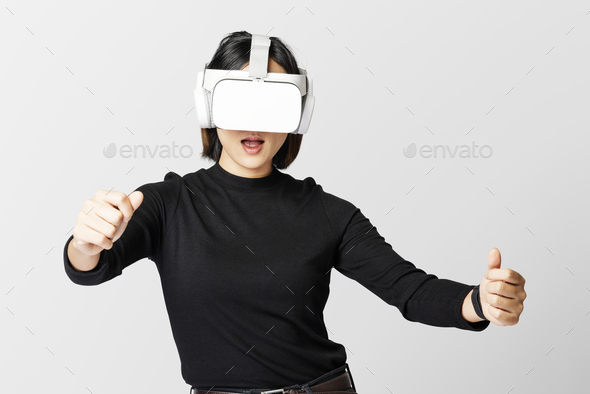 Woman with VR playing racing game - Stock Photo - Images