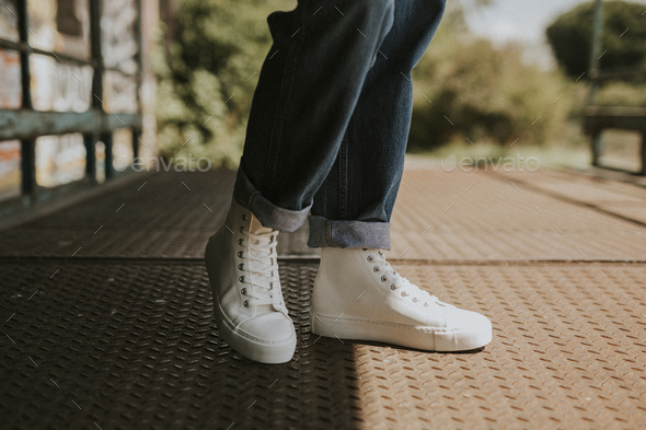 High top white sneakers on jeans model - Stock Photo - Images