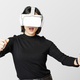 Woman with VR playing racing game - PhotoDune Item for Sale