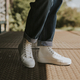 High top white sneakers on jeans model - PhotoDune Item for Sale
