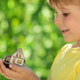 Eco house in children`s hands - PhotoDune Item for Sale