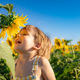 Happy child playing outdoor in spring field - PhotoDune Item for Sale