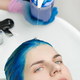 Hairdresser Squeezes Shampoo from Tube into Head of Woman with Blue Hair, Washing Hair in Sink - PhotoDune Item for Sale