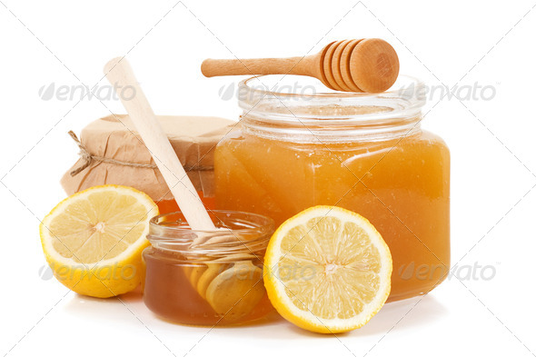 pot of honey and sliced lemon - Stock Photo - Images