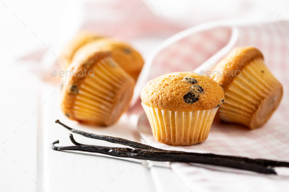 Vanilla muffins. Sweet cupcakes and vanilla pods. - Stock Photo - Images