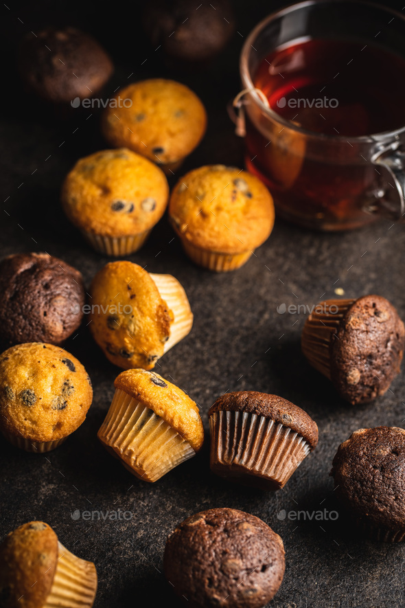 Chocolate and vanilla muffins. Sweet cupcakes. - Stock Photo - Images