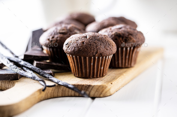 Chocolate muffins. Sweet dark cupcakes with chocolate and vanilla pods. - Stock Photo - Images