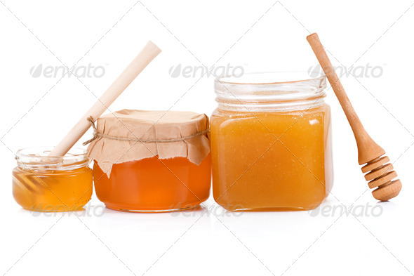 honey in glass jars isolated on white - Stock Photo - Images