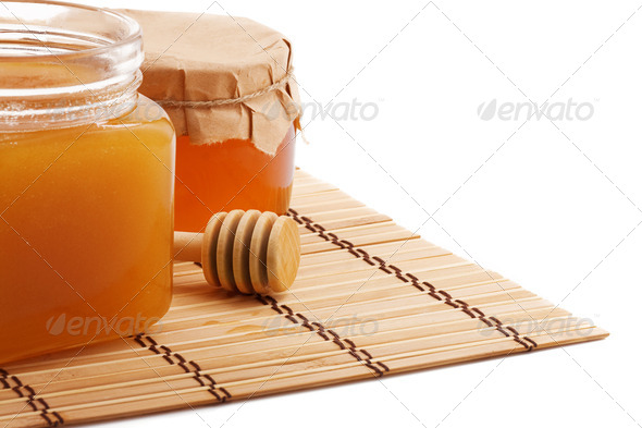 isolated pots of honey isolated on white - Stock Photo - Images