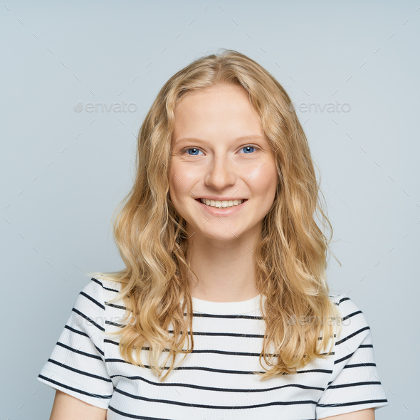 Beautiful young smiling blonde woman without makeup on white wall - Stock Photo - Images