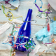 Top view of floor with after a party celebration with empty blue bottles - PhotoDune Item for Sale