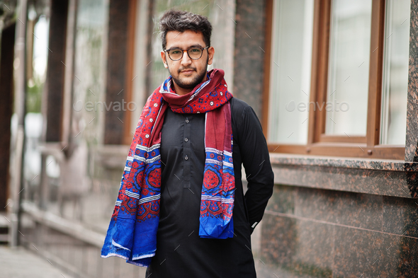 Pakistano bangladesh man wear black traditional clothes and eyeglasses pose outdoor. - Stock Photo - Images