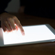 Woman finger point to screen of tablet pc at night - PhotoDune Item for Sale