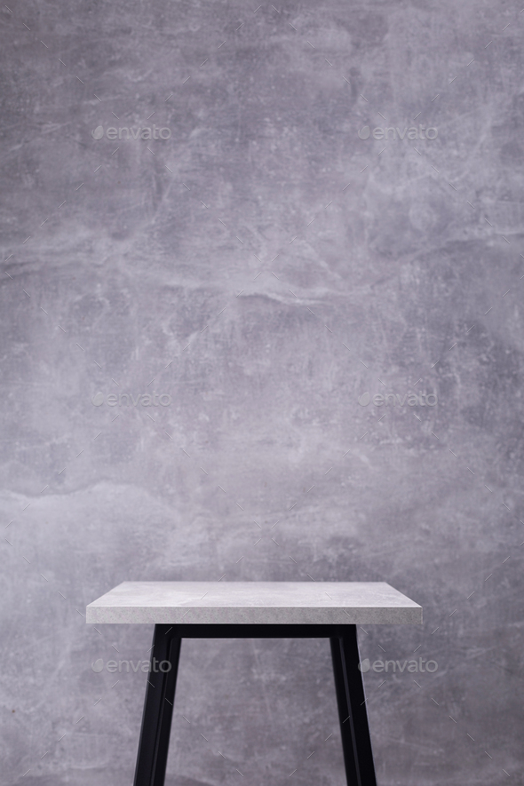 Table or metal stool with tabletop near concrete wall background - Stock Photo - Images