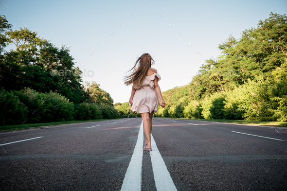 New way, new start, New year resolution, challenge, choice or change concept. Young Woman walking on - Stock Photo - Images