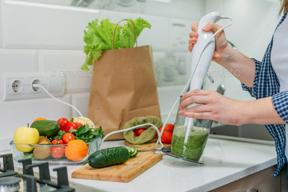 Preparing healthy meals in home kitchen. Health-conscious changes, weight loss, detox, diet, New - Stock Photo - Images