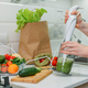 Preparing healthy meals in home kitchen. Health-conscious changes, weight loss, detox, diet, New - PhotoDune Item for Sale