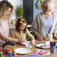 Three generations of women making handmade Easter decorations - PhotoDune Item for Sale