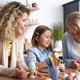 Three happy generations of women decorate easter eggs - PhotoDune Item for Sale