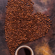 A cup of coffee and coffee beans poured in the form of a heart - PhotoDune Item for Sale