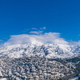 Attica Greece. Penteli mountain covered with snow, aerial drone view, blue sky background - PhotoDune Item for Sale