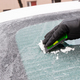 Hand in glove scraping ice or snow from car windscreen, winter problems in transportation concept - PhotoDune Item for Sale