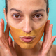 Beautiful woman using facial collagen gel skincare mask treatment - PhotoDune Item for Sale
