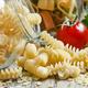 Dry Italian pasta spiraline in glass jars, selective focus - PhotoDune Item for Sale