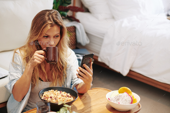 Woman enjoying breakfast at home - Stock Photo - Images