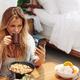 Woman enjoying breakfast at home - PhotoDune Item for Sale