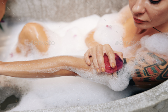 Woman washing body - Stock Photo - Images
