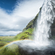 Seljalandsfoss waterfall in Iceland in Summer - PhotoDune Item for Sale