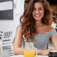 Happy cheerful adorable young woman with pleasant appearance, enjoys aromatic espresso and fresh ora - PhotoDune Item for Sale