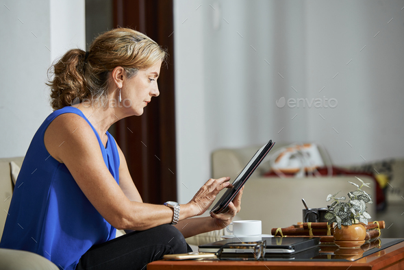 Woman reading news article - Stock Photo - Images