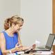 Woman managing household finances - PhotoDune Item for Sale