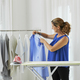 woman hanging ironed clothes - PhotoDune Item for Sale